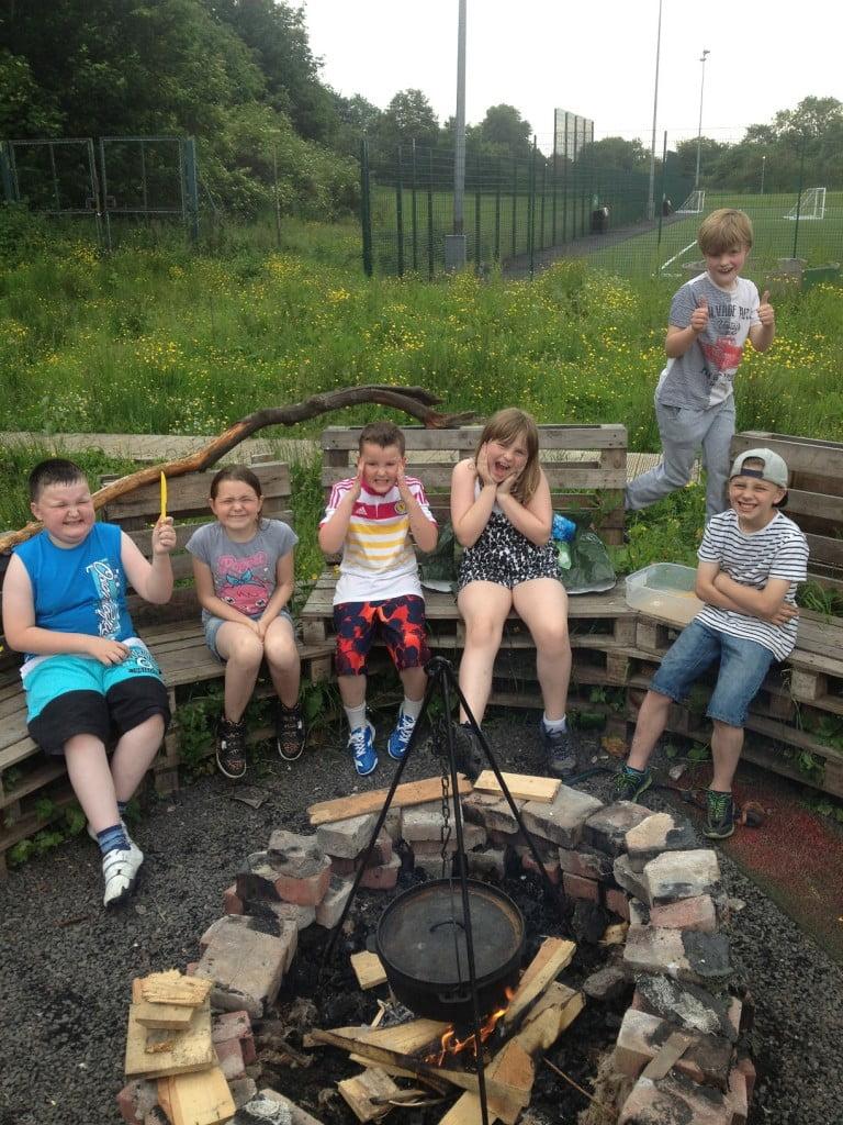 Kids around campfire